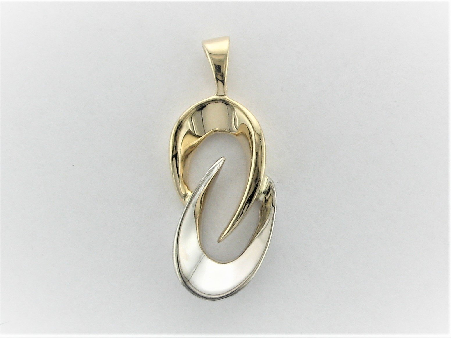 Two Tone Freeform Pendant Set in 14 Karat Yellow and White Gold