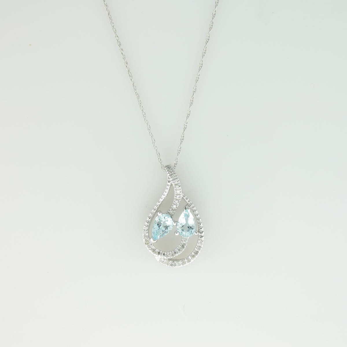 0.64tcw Aquamarine and Diamond Necklace set in 14k White Gold
