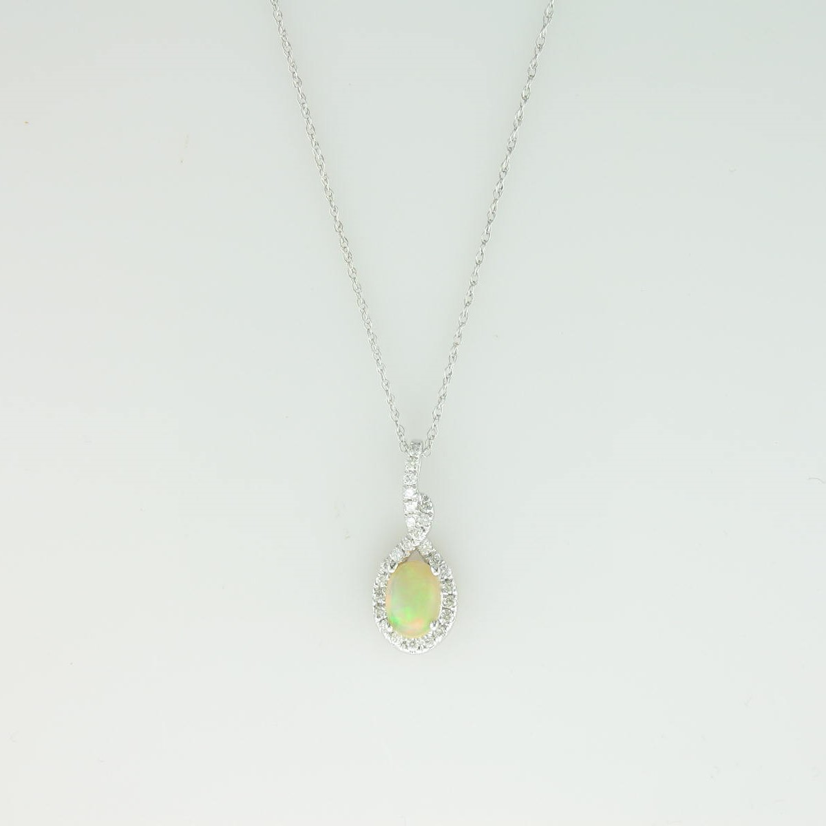 0.60ct Ethiopian Opal & Diamond Necklace set in 14k White Gold