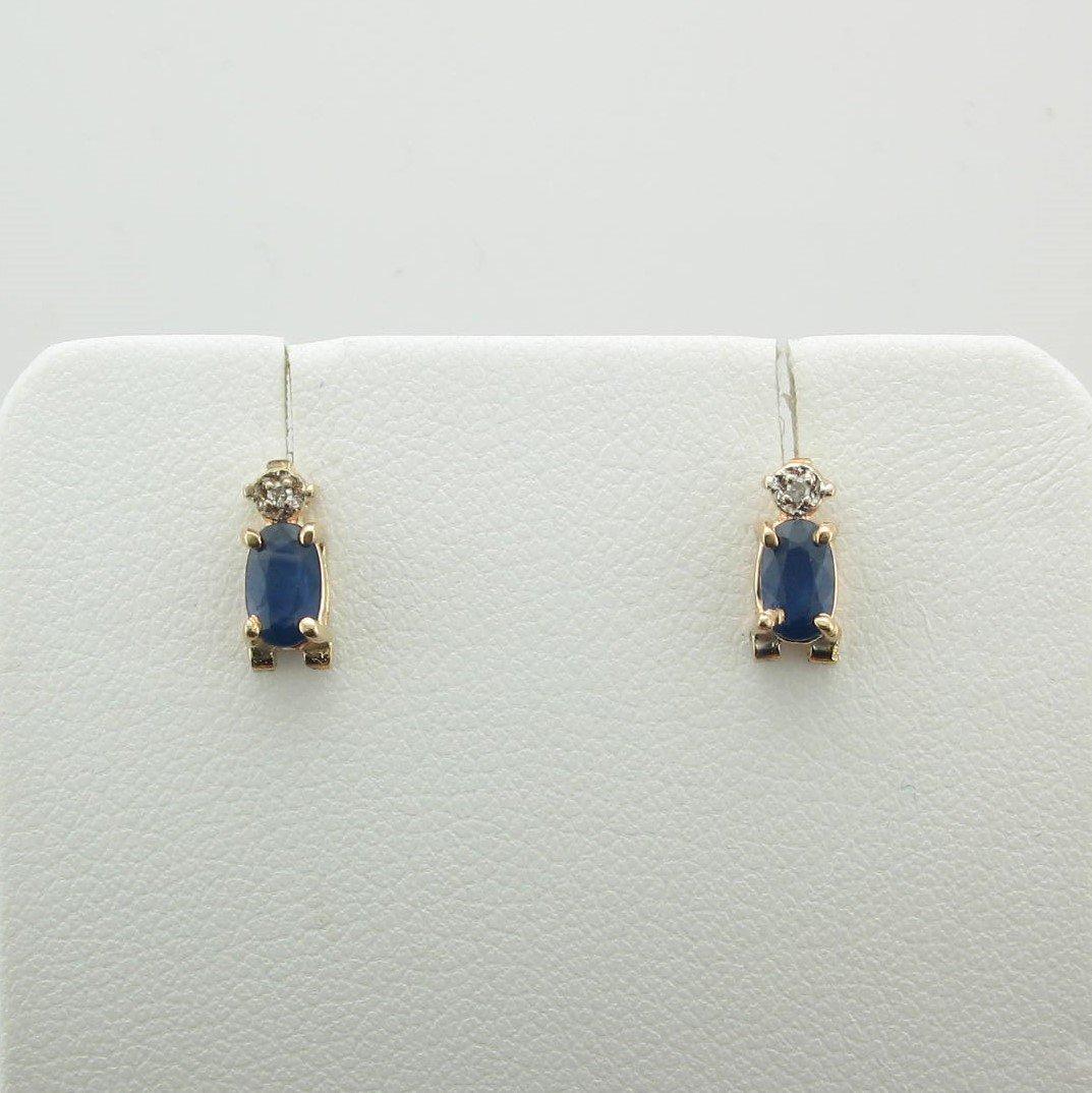 Oval Blue Sapphire with Diamond Earrings set in 14 Karat Yellow Gold