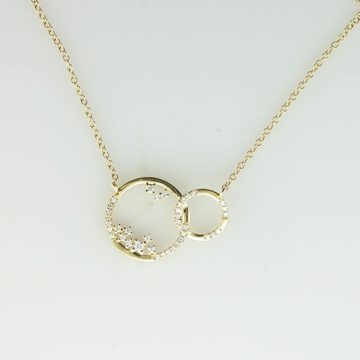 0.15tcw Diamond Connected Circles Necklace set in 14K Yellow Gold