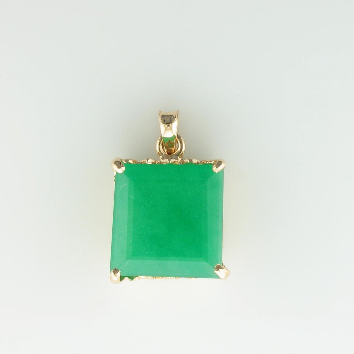 10ct Emerald Pendant set in 10K Yellow Gold