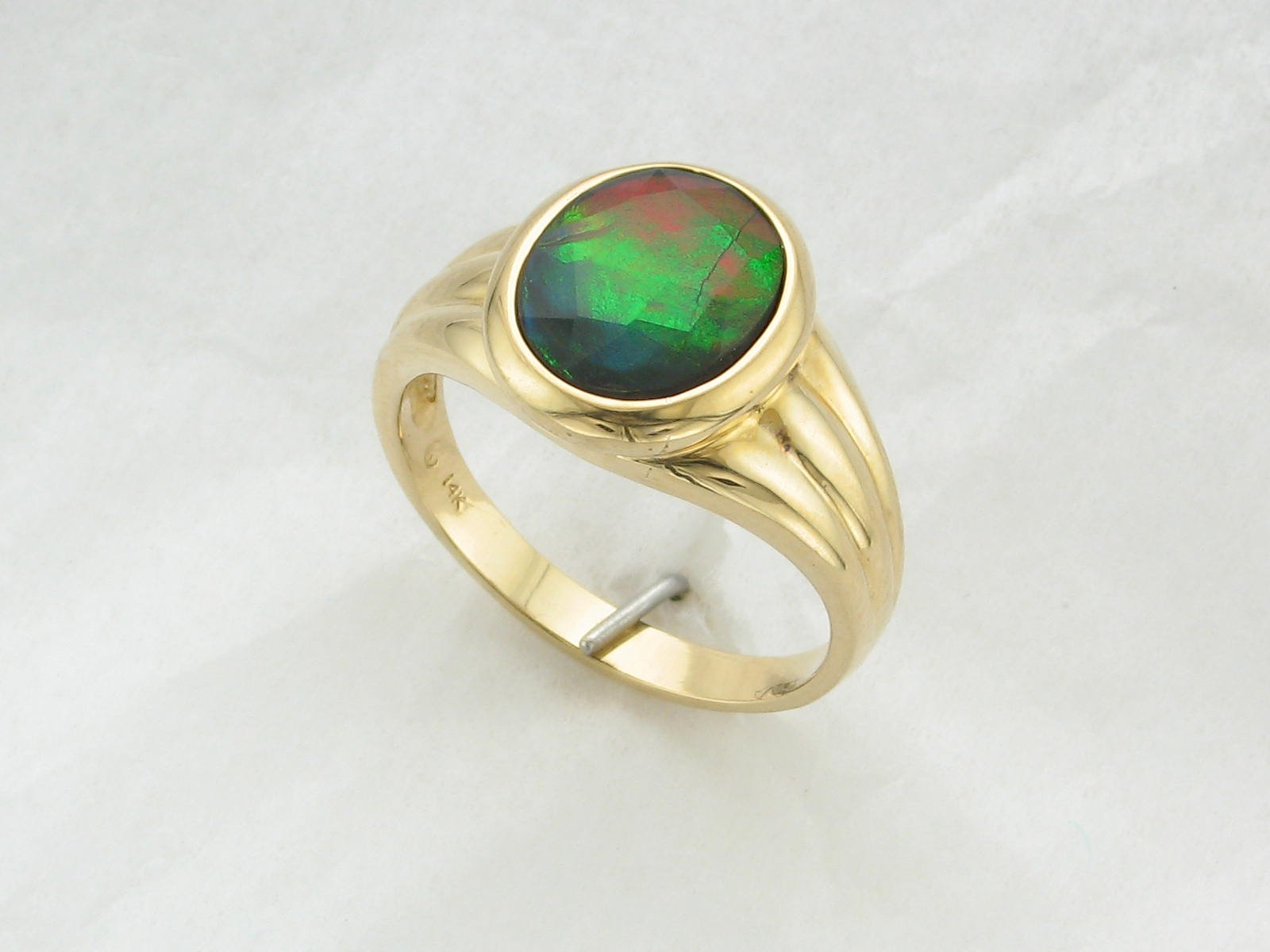A Grade Oval Ammolite Ring Set in 14K Yellow Gold