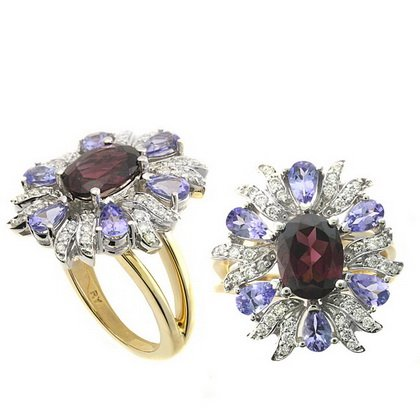 3.70 Total Carat Weight Oval Rhodolite Garnet and Tanzanite and .28 Total Carat Weight Diamonds Ring Set in 14 Karat Two Tone Gold White and Yellow