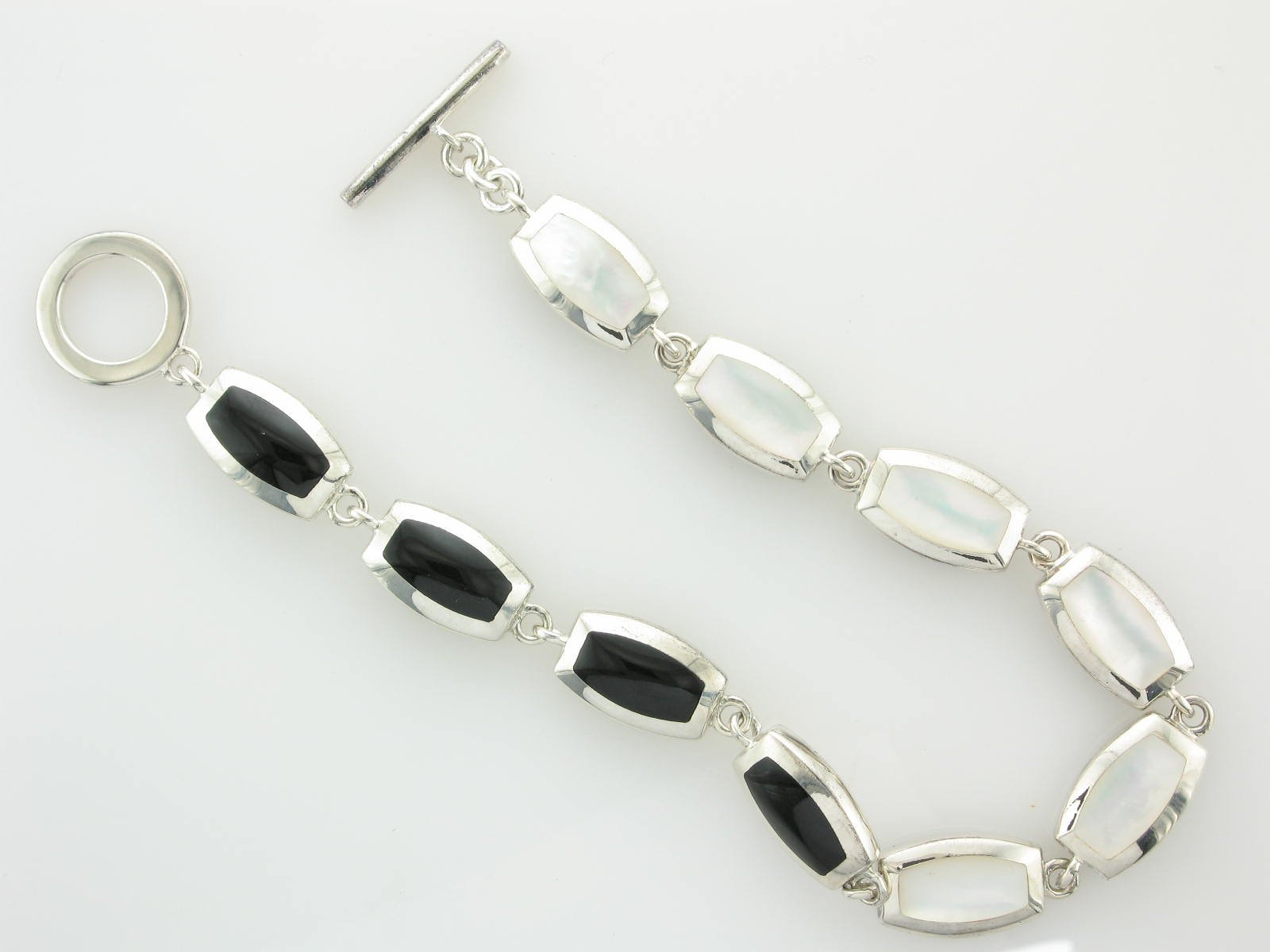 7.5 Onyx & Mother of Pearl Reversable Bracelet set in Sterling Silver