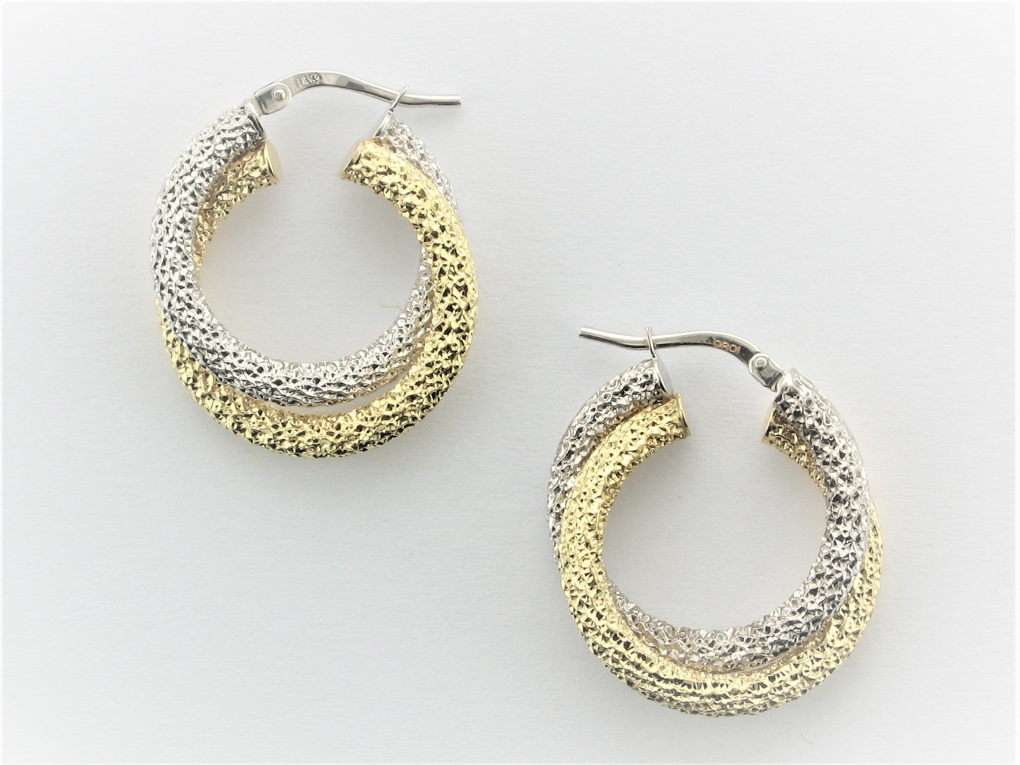 Two-Tone Diamond Cut Twisted Hoops Set in 14 Karat Yellow and White Gold