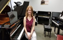 Picture of Wendy Curtis next to piano