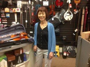 Noriko Kuroda next to violin