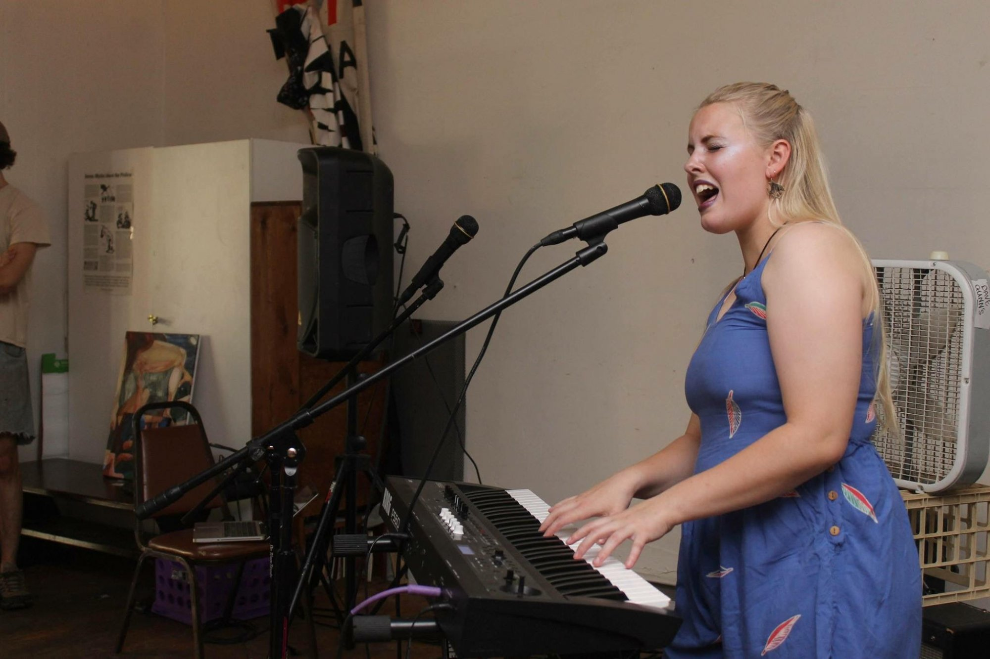 Gracie Lineham singing and playing piano