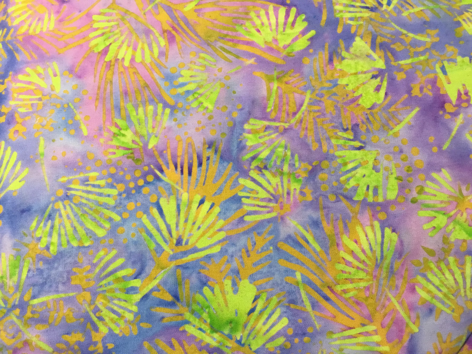 Island Batiks color: green Ferns with purple background
