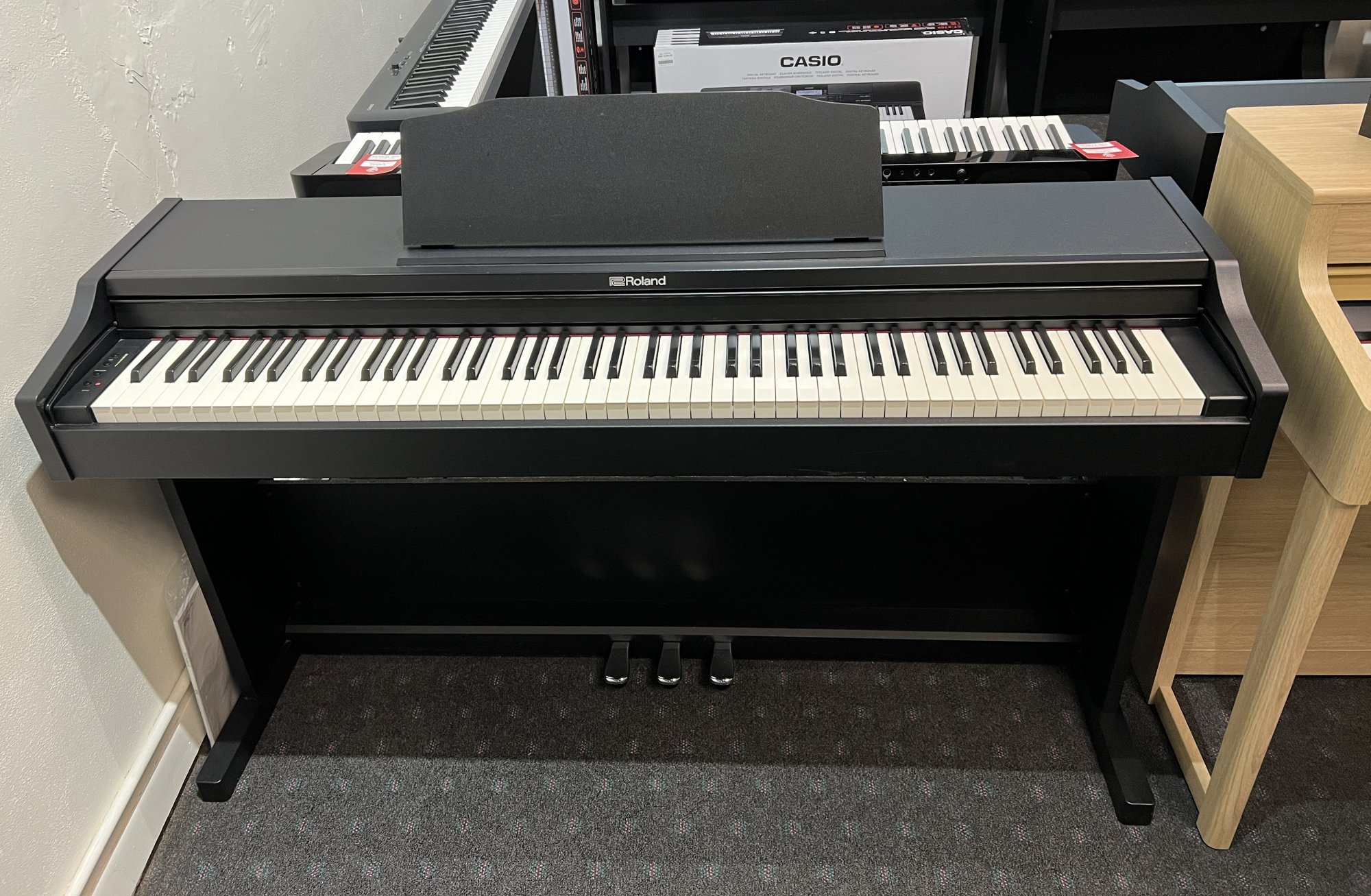 Used Roland RP102 88 Note Digital Piano