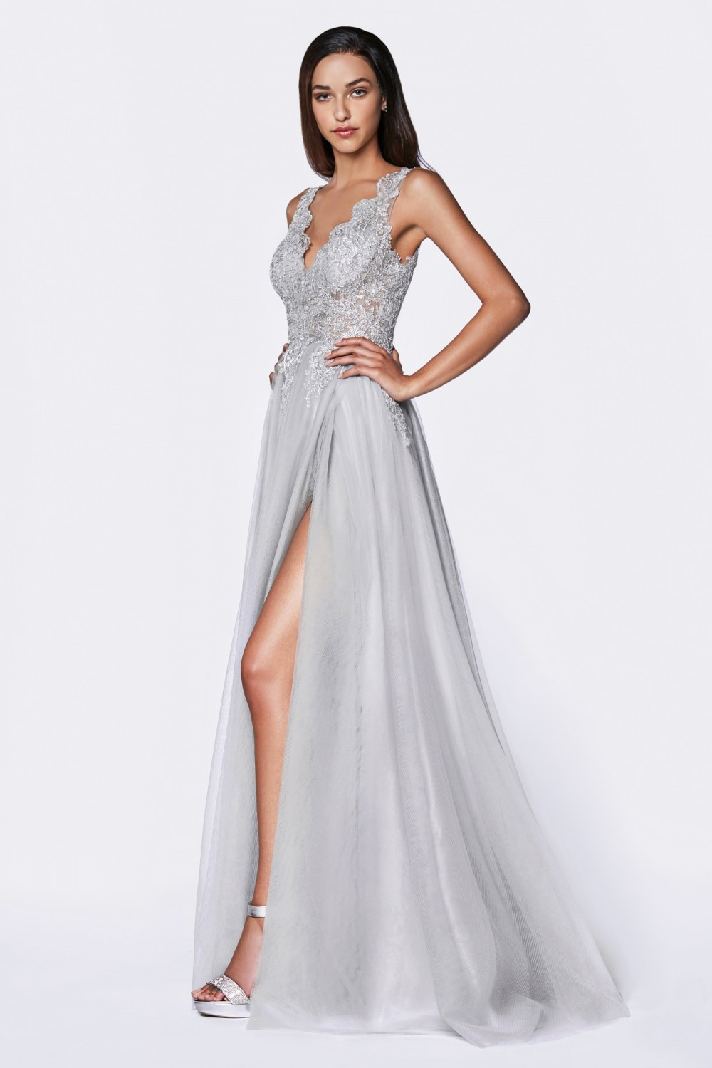 Silver A-line tulle gown with deep v-neckline and high slit.