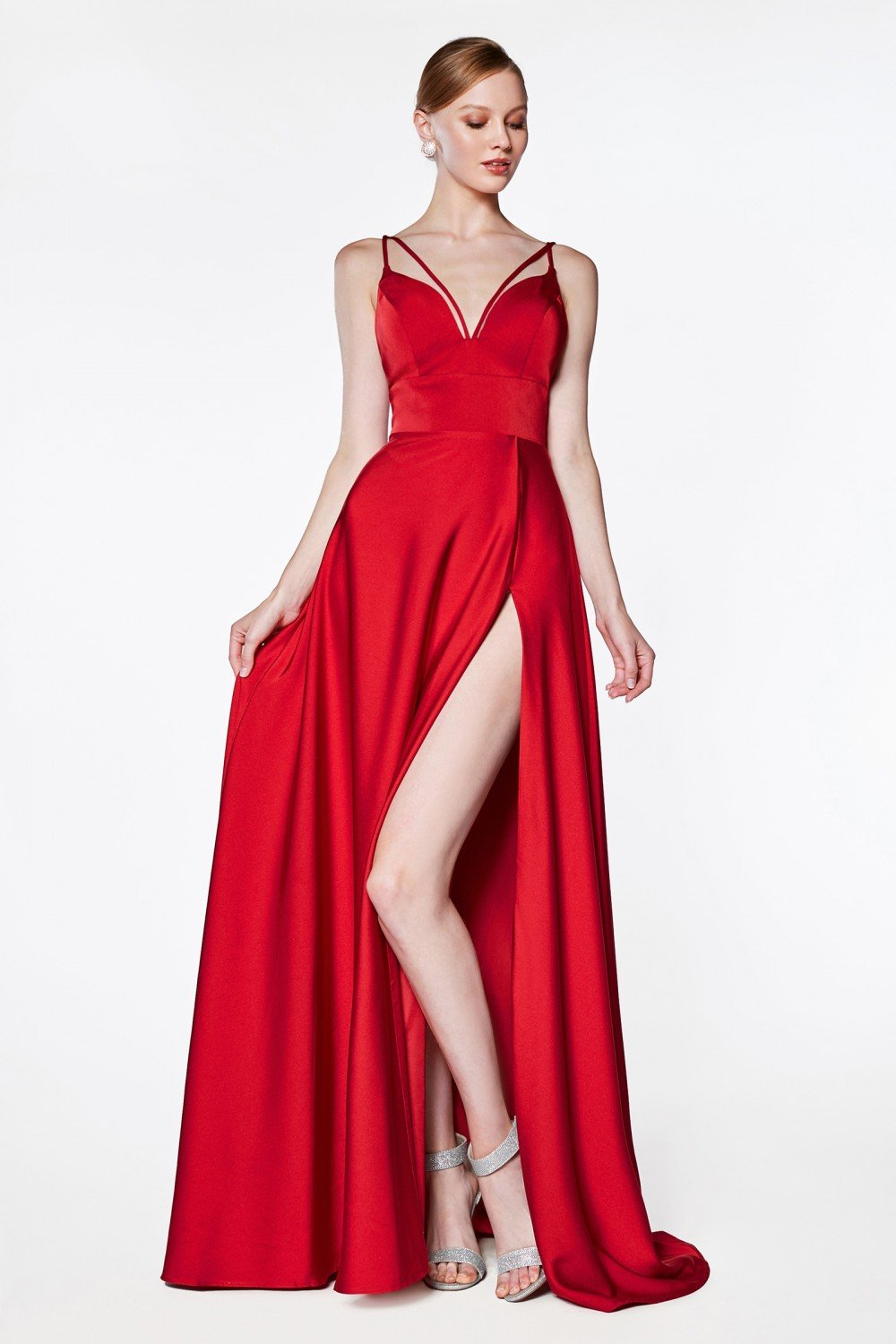Red A-line v-neckline gown with slit and double strap.