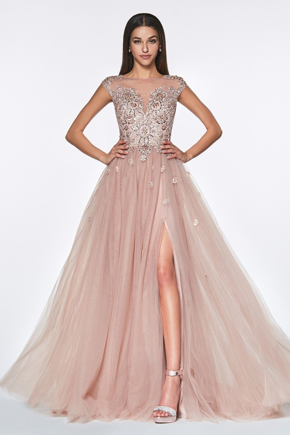 A-line tulle gown with cap sleeve beaded lace applique and leg slit.