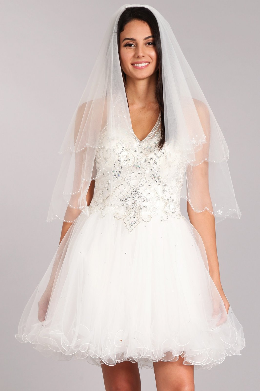 36 White lace veil with jeweled and beaded trim embellishments.