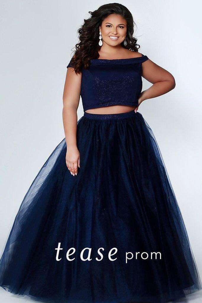 Glitter the night away in this Indigo plus size prom dress