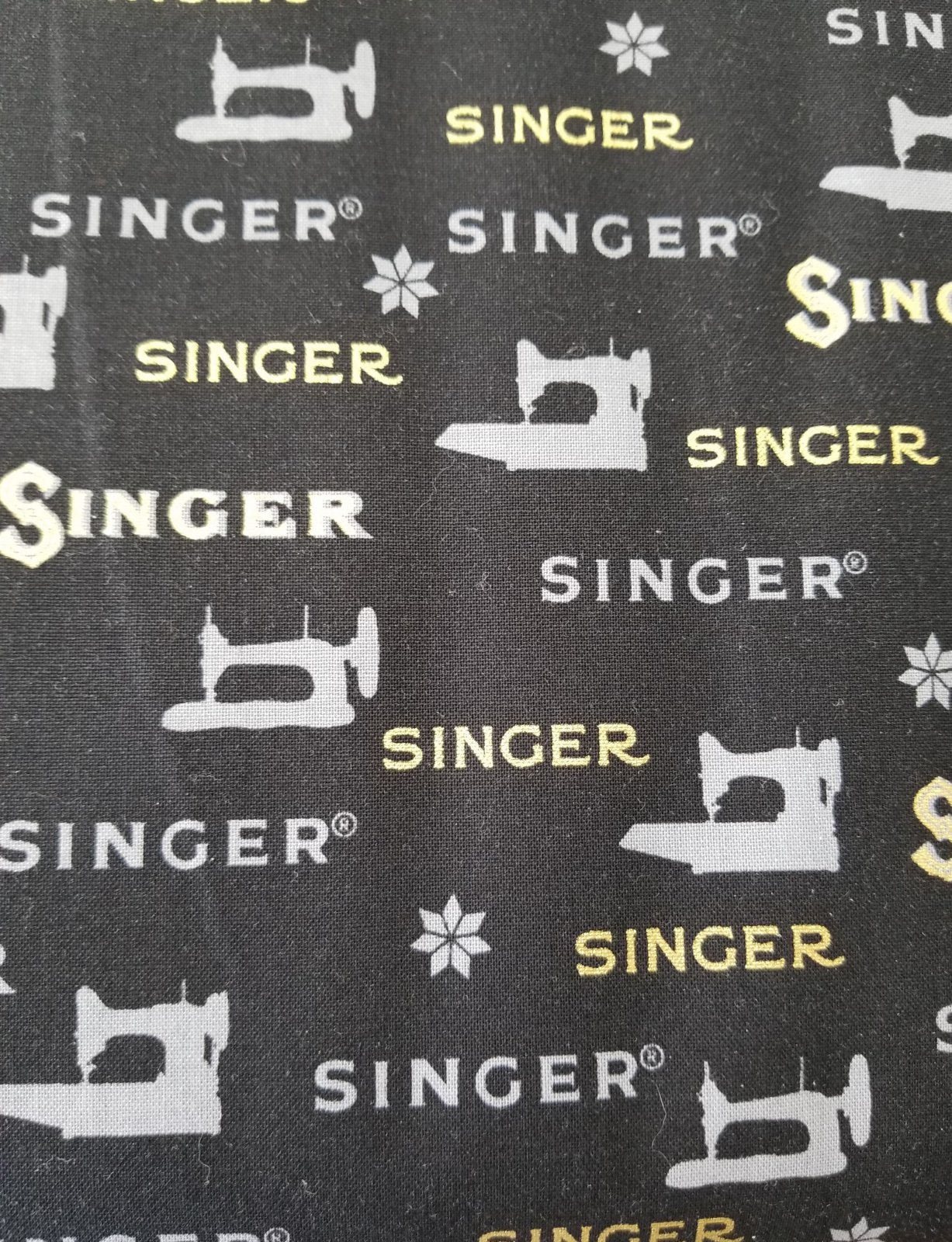 Sewing with Singer Black Background Gold Lettering