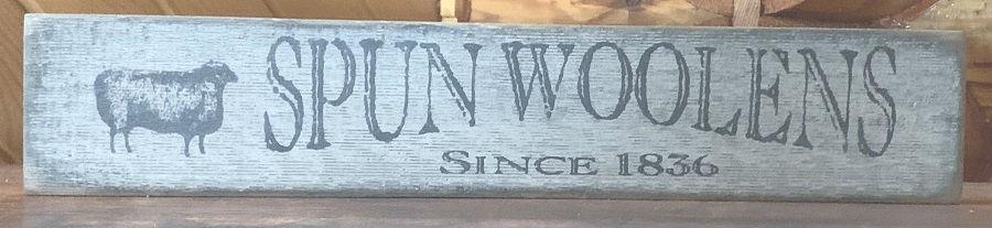 Spun Woolens Sign