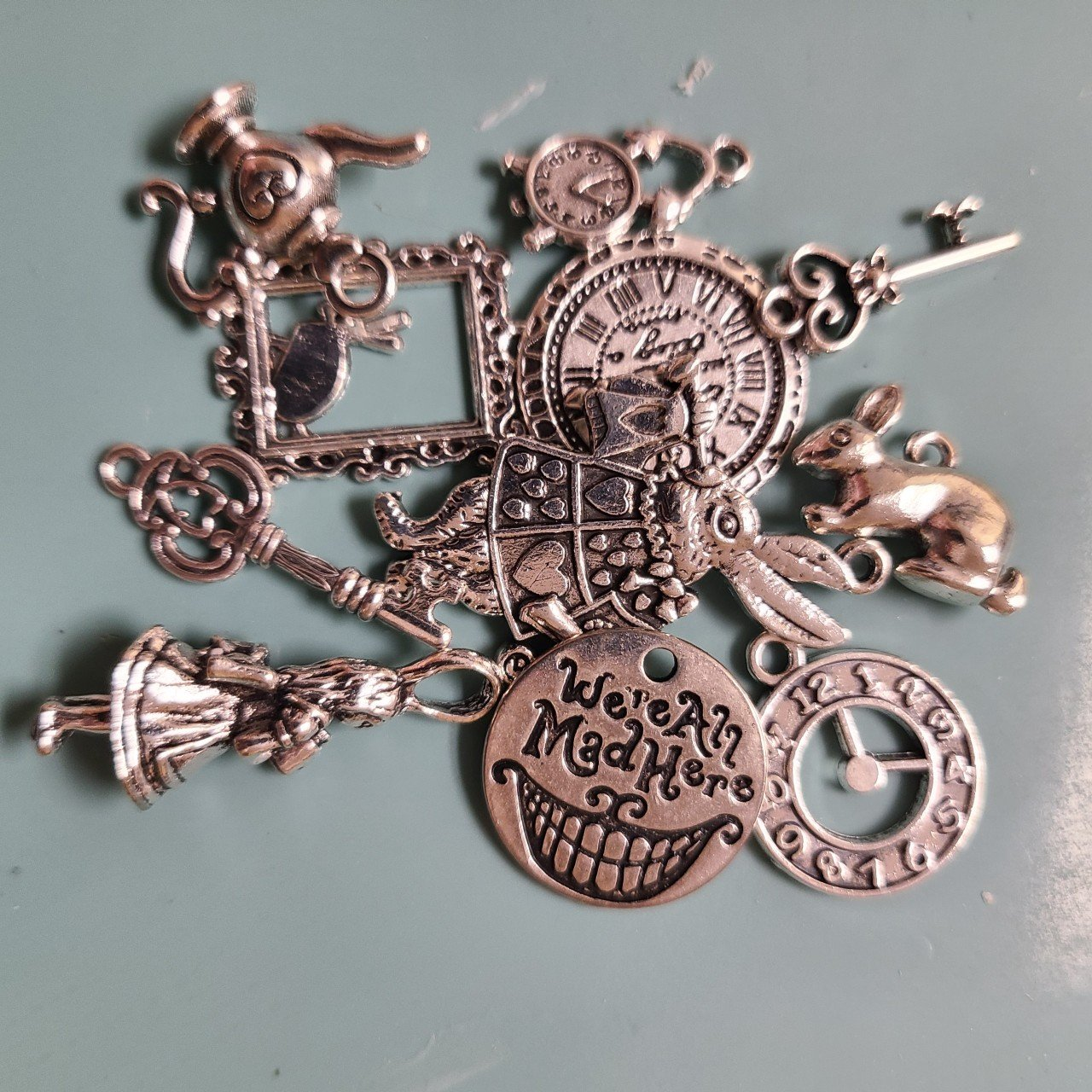 chick here for all Alice in wonderland Tibetan charms pack of 12