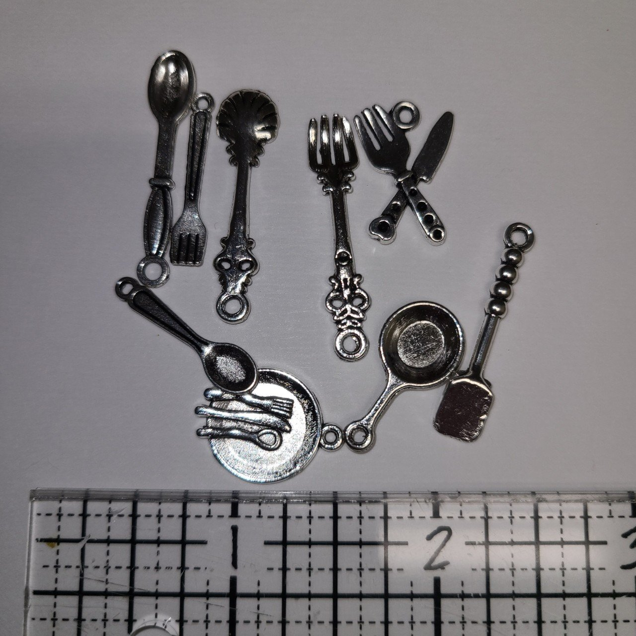 Silver Cooking Tibetan charms  10 charms per pack