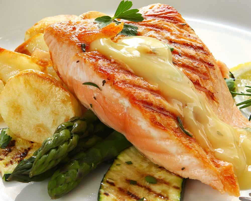 Salmon and Asparagus on a Plate with Sauce