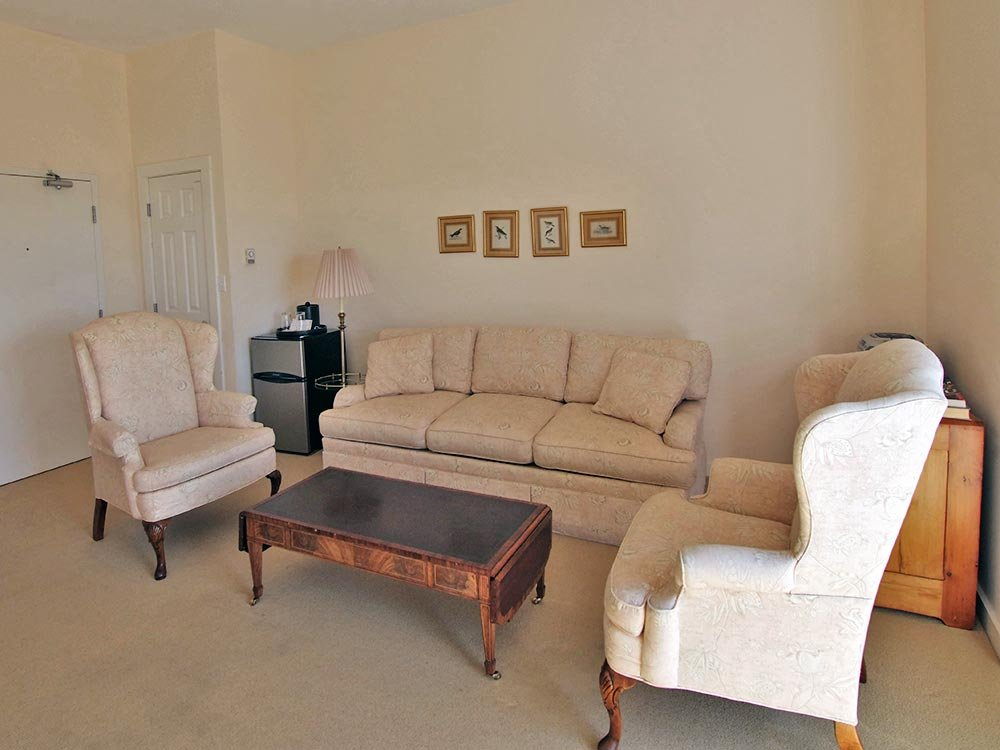 Family Room with Beige Couch and Chair