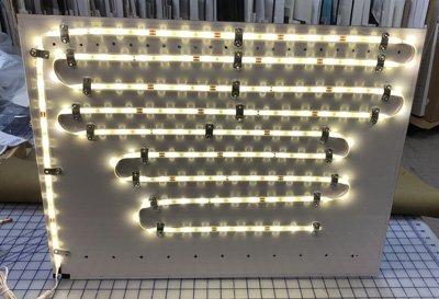 LED strip lighting lit up on shadowbox backing