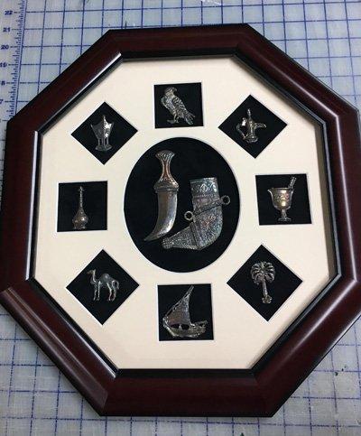 Ocetagonal shadowbox frame with silver ornaments