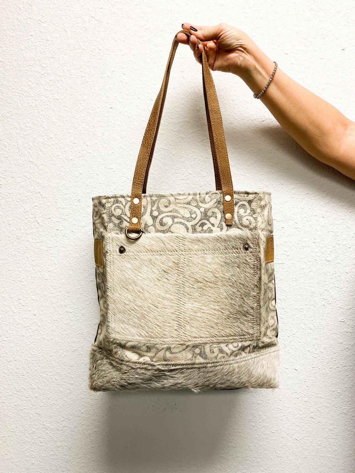Myra Bags Myrabag gives cowhide bag, old military tarp and tent bag, unique and fashionably chic bag. myra bags