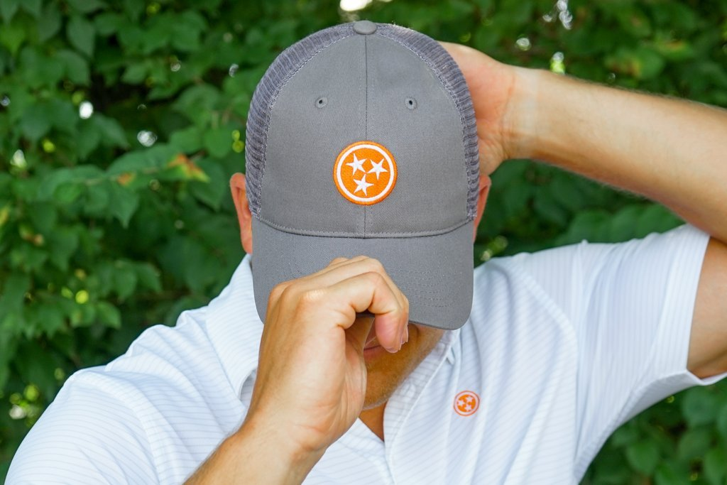 Gray trucker with orange tristar