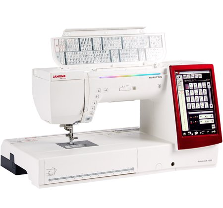 Janome MC14000 Quilt & Embroider w/Embroidery quilting hoop & bonus package. Floor Model