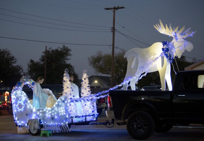 Company mascot pulls lighted sleigh