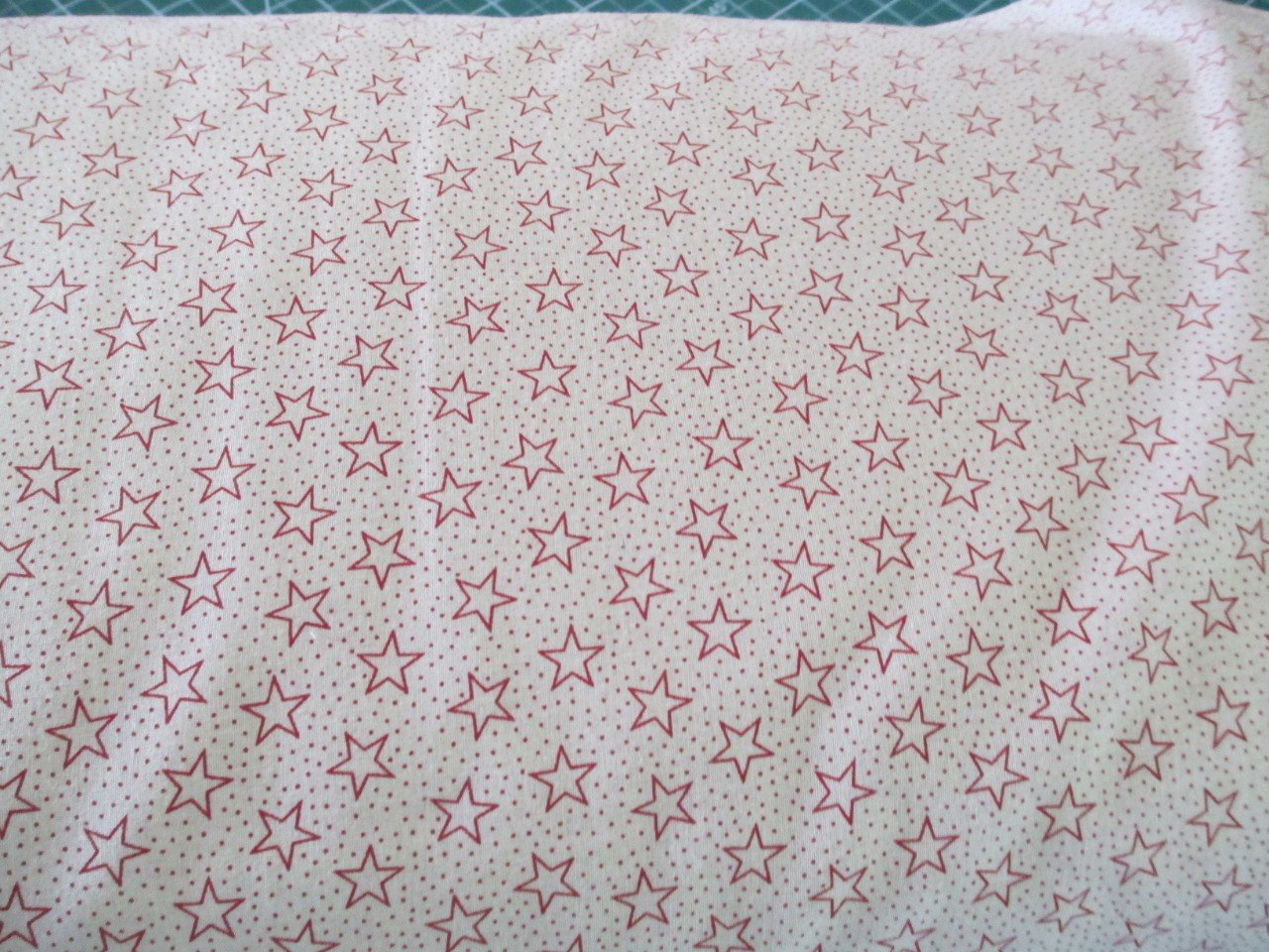 Red Stars on Cream backing