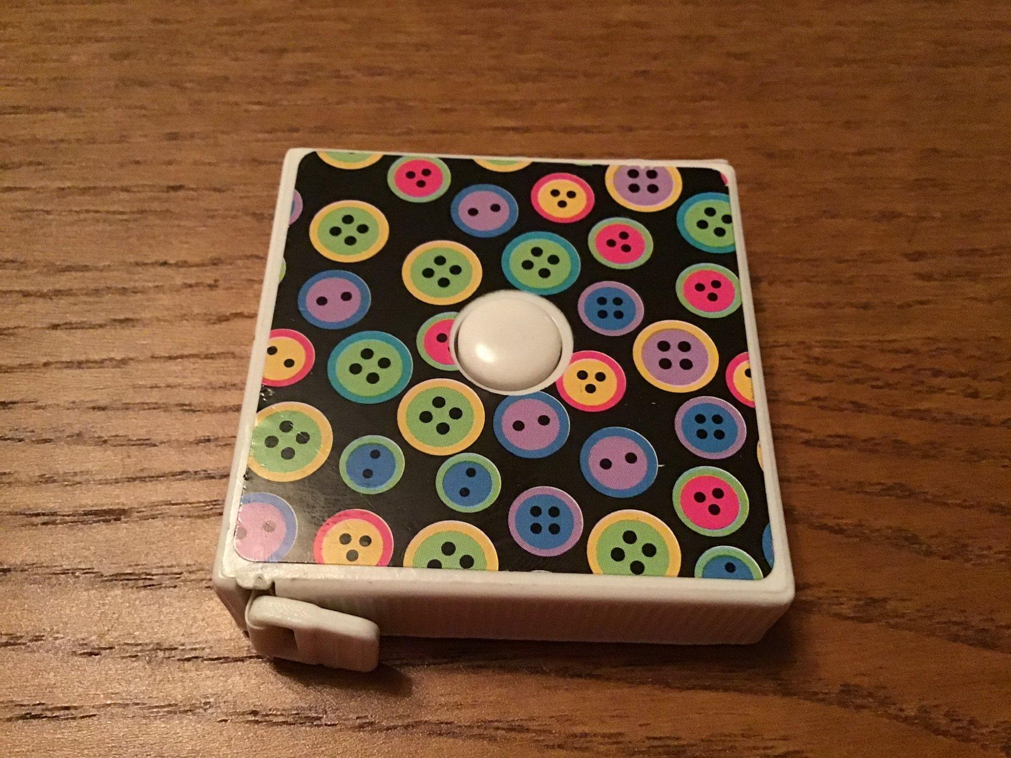 Tape Measure Button Design