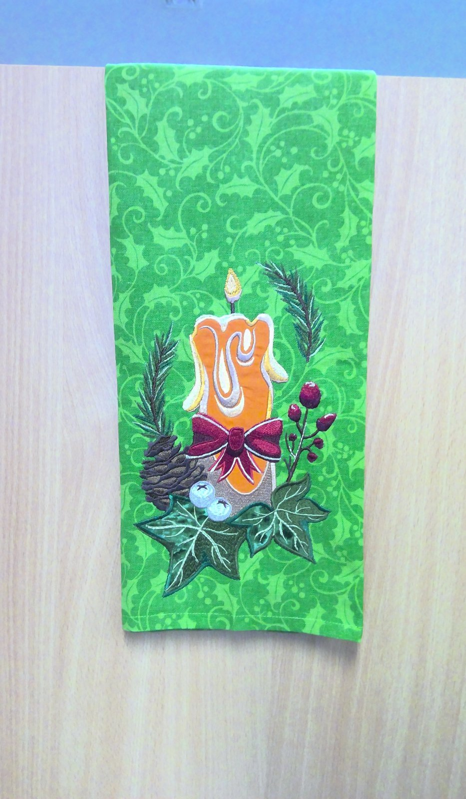 Green Holly Towel with an embroidered candle