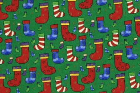 Holiday Stockings with gold on a green background