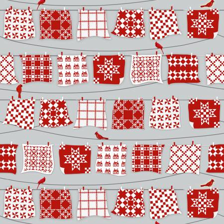 Grey/Red Red & White Quilts Hanging on Line