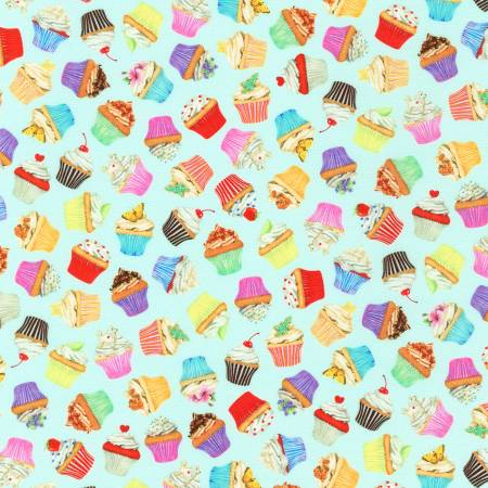 Cupcakes on mint background