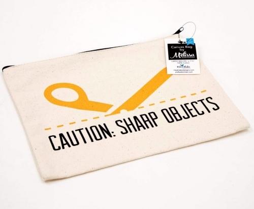 CAUTION: Sharp Objects Large Canvas Zipper Bag