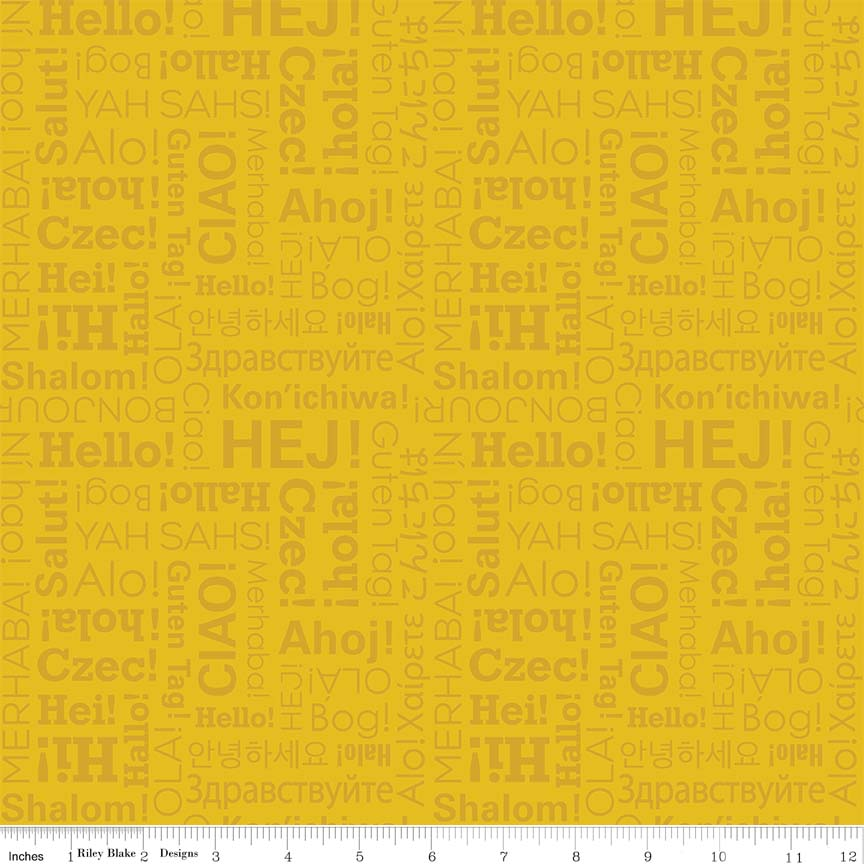 Hello written in various languages on Golden Yellow:  Hello World - Our World by Lori Whitlock for Riley Blake