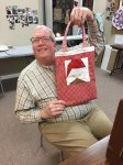 kirk with his paper piecing project he made for his little girl.  He turned his into a bag.