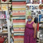 Sandy with her Jelly Roll Table Runner